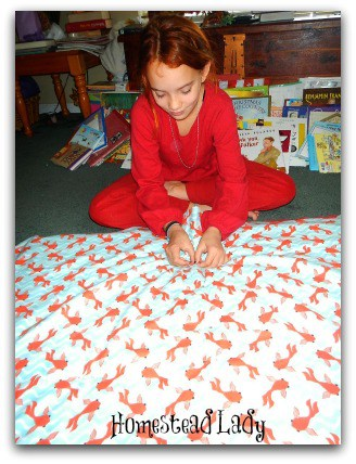 Christmas Quilts - An easy service project for kids l Make a blanket in a few hours l Homestead Lady (.com)