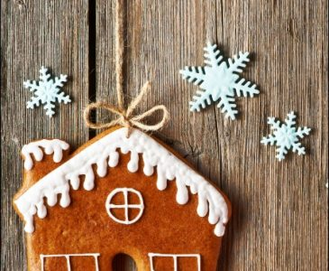 Gingerbread House with Snowflakes on wooden board