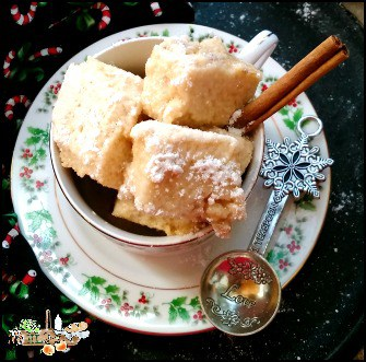apple cider marshmallows in a tea cup with cinnamon stick